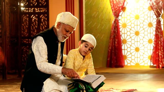 MS ZI Grandfather and grandson reading quran at home / Delhi, India