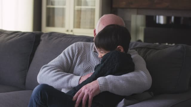 grandfather and grandson share special moment - cosy stock videos & royalty-free footage