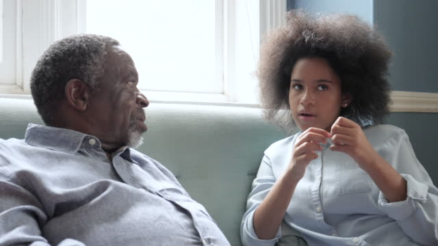 grandfather and grandson talk on sofa, close up - grandfather stock videos & royalty-free footage