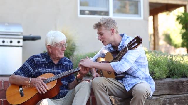 grandfather and teenage grandson - männliche person stock-videos und b-roll-filmmaterial