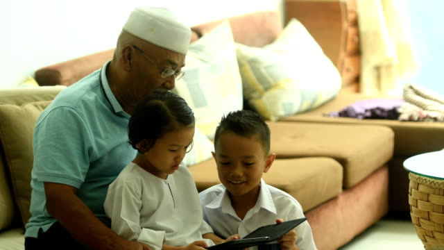 grandfather bonding with his grandchildren with technology - malaysia stock videos & royalty-free footage