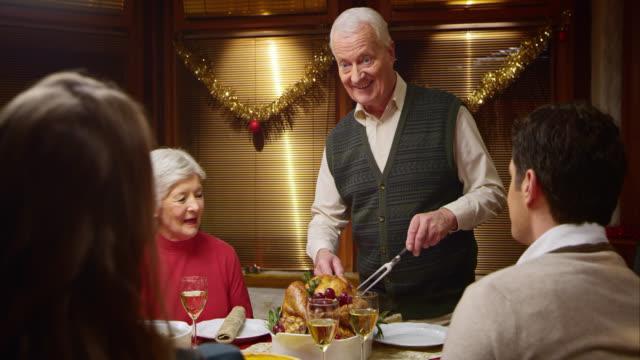 SLO MO grandfather cutting the Christmas turkey