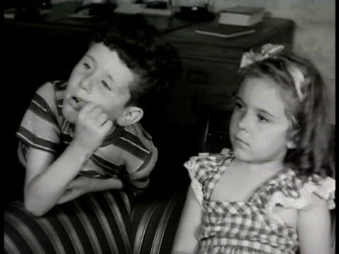 grandfather in living room talking to children neighbor saying he's against operations relating story about having appendix out doctor interrupting... - 1948 stock-videos und b-roll-filmmaterial