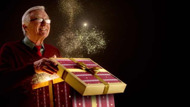 grandfather opening christmas gift - christmas gift stock videos & royalty-free footage