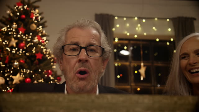 grandfather opening christmas present - christmas gift stock videos and b-roll footage