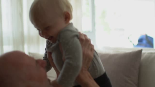grandfather playing with his grandson at home - candid stock videos & royalty-free footage