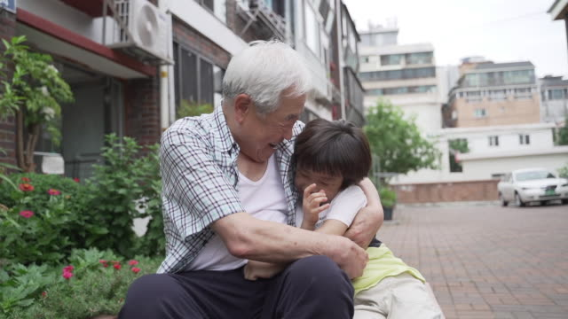 grandfather playing with his grandson, seoul, south korea - vest stock videos & royalty-free footage