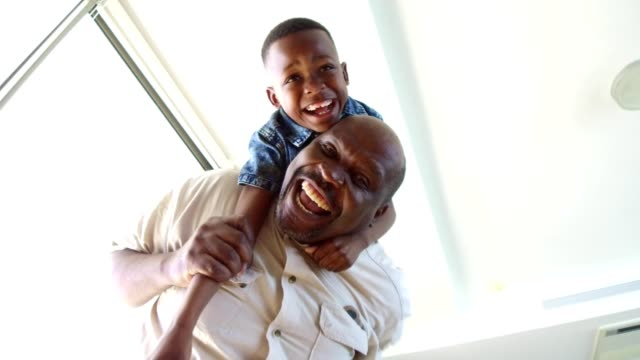 grandfather playing with his grandson - mature men stock videos & royalty-free footage