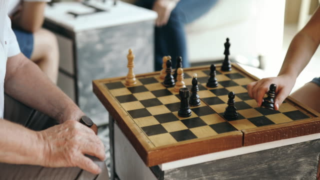 grandfather teaches grandson how to play chess - chess stock videos & royalty-free footage