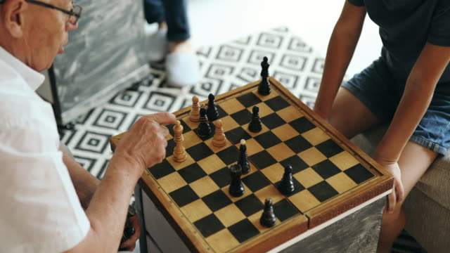 grandfather teaches how to play chess - grandfather stock videos & royalty-free footage