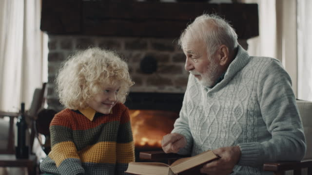 grandfather telling a funny story - storytelling stock videos & royalty-free footage
