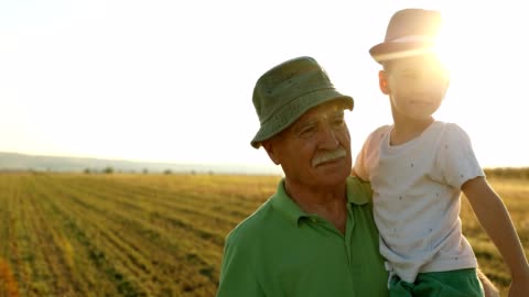 grandfather walking outdoors with grandson - rural scene stock videos & royalty-free footage