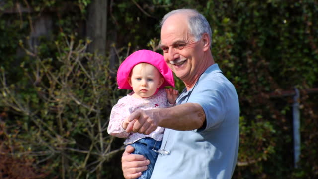 grandfather walks with granddaughter - granddaughter stock videos & royalty-free footage
