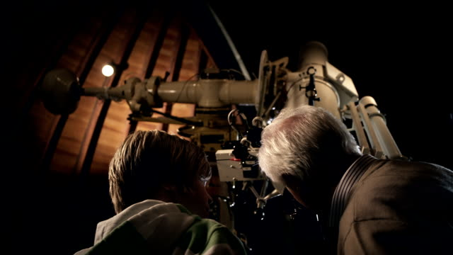 Grandfather with Grandson in observatory