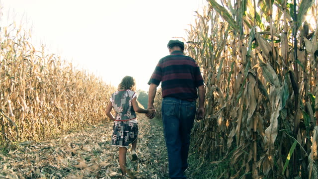 HD DOLLY: Grandfather With His Granddaughter In Corn Field