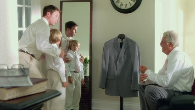 ms grandfather with son and grandson (8-9) getting ready for wedding / tampa, florida, usa - adjusting stock videos & royalty-free footage