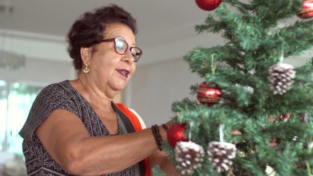 grandma decorating the christmas tree - pardo brazilian stock videos & royalty-free footage