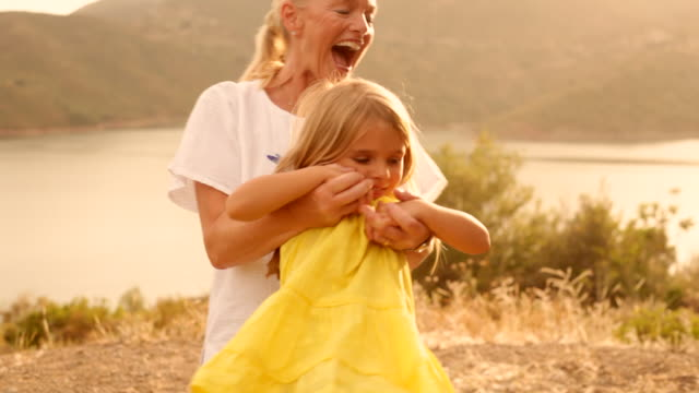grandmother and grandchild playing in sunset - twilight stock videos & royalty-free footage