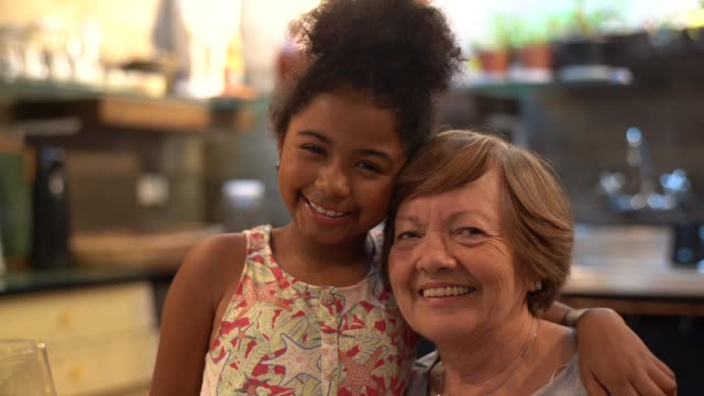 grandmother and granddaughter at kitchen - adoption stock videos & royalty-free footage