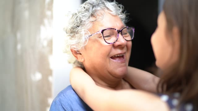 grandmother and granddaughter embracing and talking at home - i love you stock videos & royalty-free footage