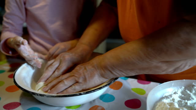 grandmother and granddaughter kneading homemade dough - rolling pin stock videos & royalty-free footage