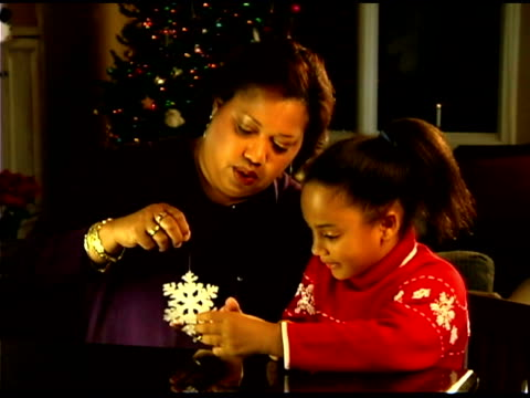grandmother and granddaughter with snowflake christmas ornament - see other clips from this shoot 1407 stock videos and b-roll footage