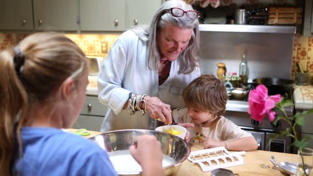 grandmother and grandkids in kitchen