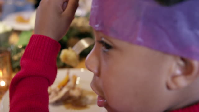 grandmother and grandson at christmas table - roast turkey stock videos & royalty-free footage