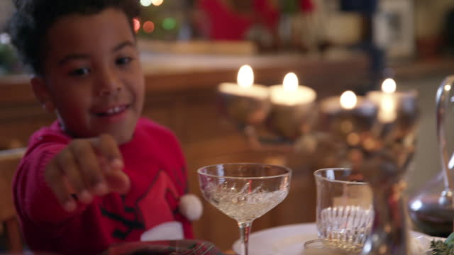 grandmother and grandson at christmas table - dining room stock videos & royalty-free footage
