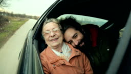 Grandmother and grandson in the car