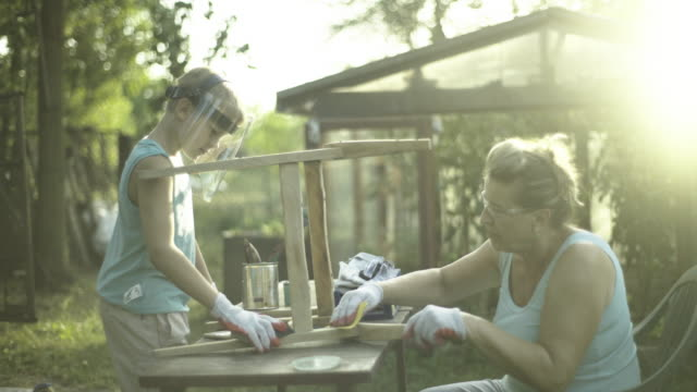 grandmother and grandson renovate old furniture - focus stock videos & royalty-free footage
