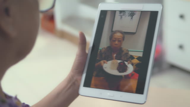 grandmother birthday video call - video call stock videos & royalty-free footage