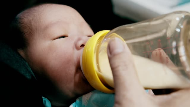 grandmother bottle feeding toddler grandson - toddler stock videos & royalty-free footage