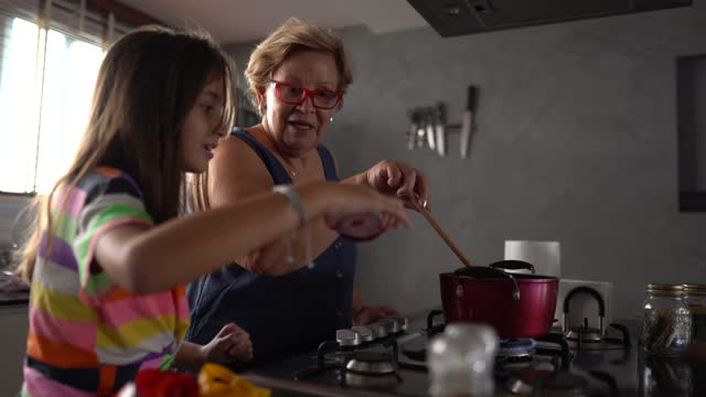 grandmother cooking with granddaughters at home - lunch stock videos & royalty-free footage