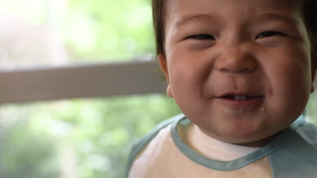 grandmother feeding baby food to her grand son - day in the life stock videos & royalty-free footage