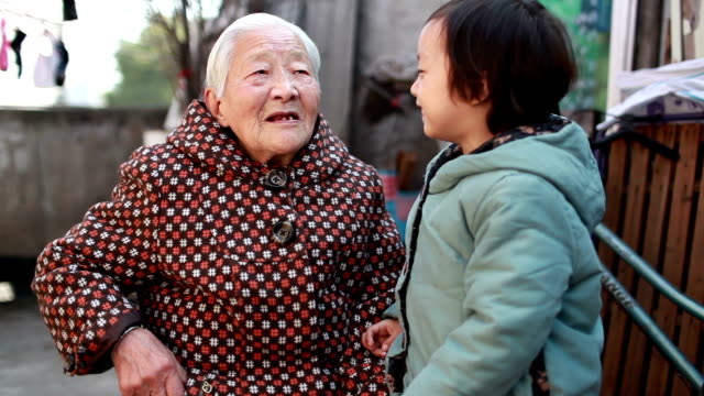 grandmother gave grandson a red envelope - chinese new year stock videos & royalty-free footage