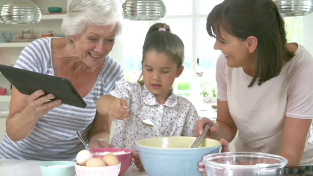 grandmother, granddaughter and mother baking cake in kitchen - nutrition label stock videos and b-roll footage