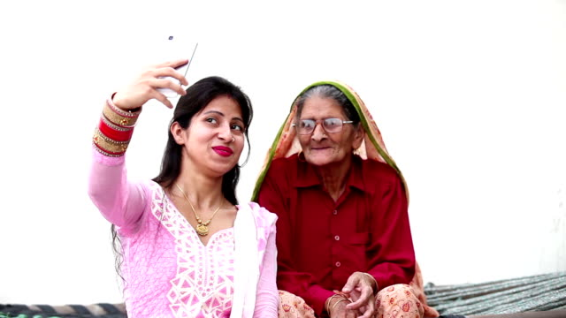 grandmother & granddaughter taking  a selfie - indian mom stock videos & royalty-free footage