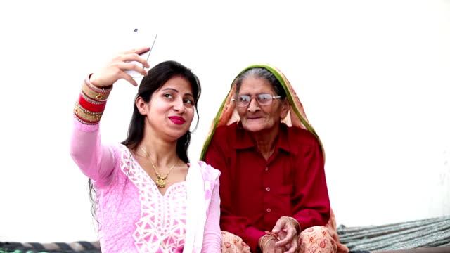 grandmother & granddaughter taking  a selfie - granddaughter stock videos & royalty-free footage