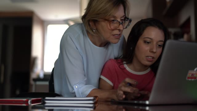 grandmother helping granddaughter in her homework - homework stock videos & royalty-free footage