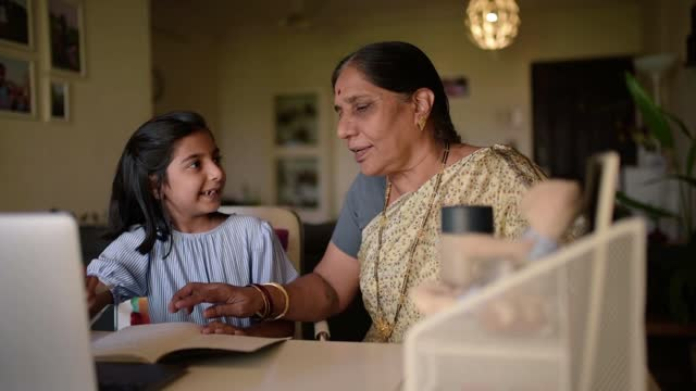 grandmother helping her granddaughter in the homework - assistance stock videos & royalty-free footage