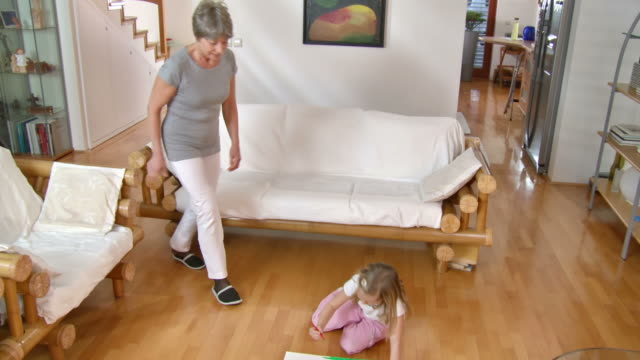 hd dolly: grandmother helping her granddaughter to draw - wooden floor stock videos & royalty-free footage