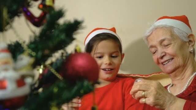 grandmother is holding snow globe - storyteller stock videos & royalty-free footage
