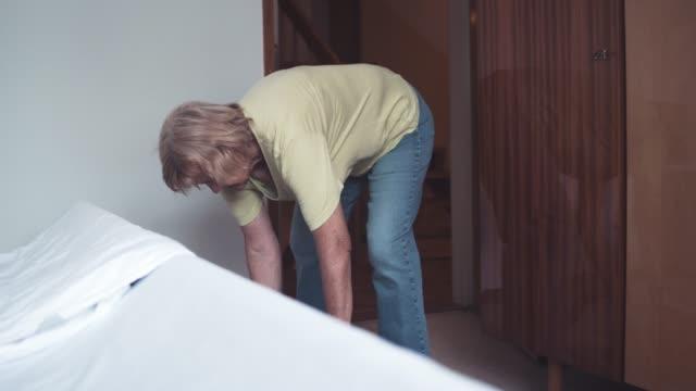 Grandmother is hoovering the floor