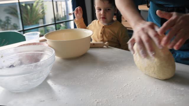 grandmother kneading yeast dough - kneading stock videos & royalty-free footage