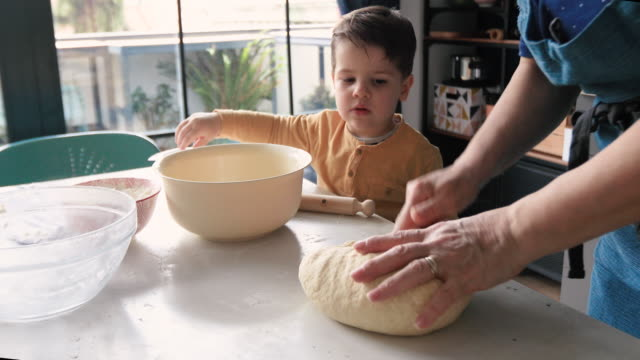 grandmother kneading yeast dough - baked stock videos & royalty-free footage