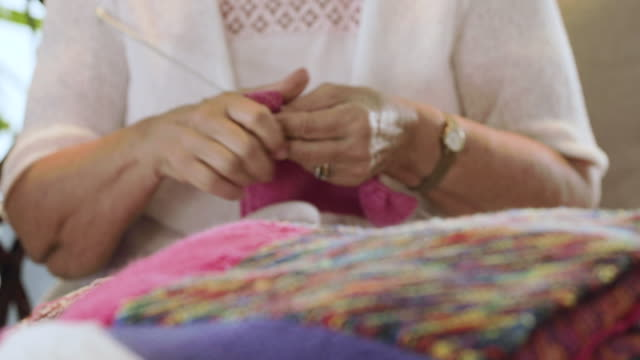 a grandmother knitting - rheumatism stock videos & royalty-free footage