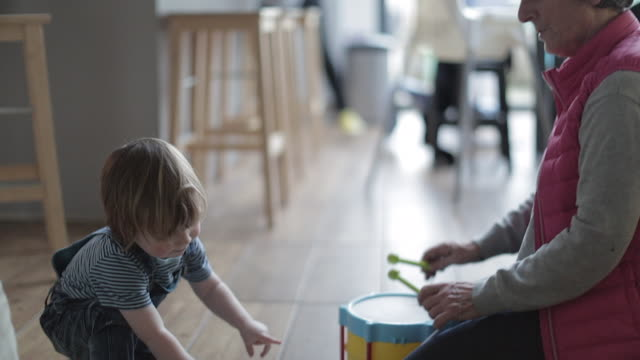 vídeos de stock, filmes e b-roll de grandmother playing musical toys with grandson - brinquedo