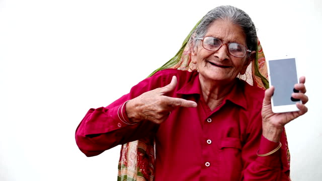 grandmother pointing to the smartphone - indian culture stock videos & royalty-free footage