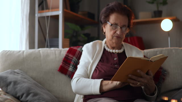 grandmother reading book at home - over 80 stock videos and b-roll footage